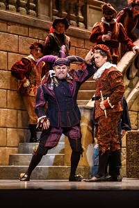 Rigoletto (Mark Delavan) ridicules Count Ceprano (Adam Fry) after it's discovered that the Duke has been romancing Countess Ceprano.