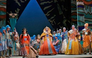 (L-R) Mezzo soprano Jill Grove is Amneris, tenor Greg Fedderly (kneeling) is the Messenger, bass baritone Ashraf Sewailam is the King of Egypt and bass Reinhard Hagen is Ramfis in San Diego Opera's AIDA, April 2013. Photo © Ken Howard.