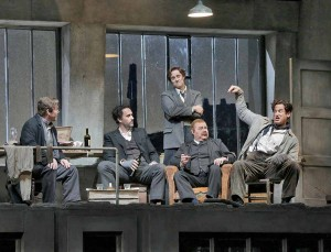 (L-R) Baritone Malcolm MacKenzie is Schaunard, bass-baritone Christian Van Horn is Colline, tenor Harold Meers is Rodolfo, bass Scott Sikon is Benoit and baritone Morgan Smith in Marcello. Photo by Ken Howard, 2015.