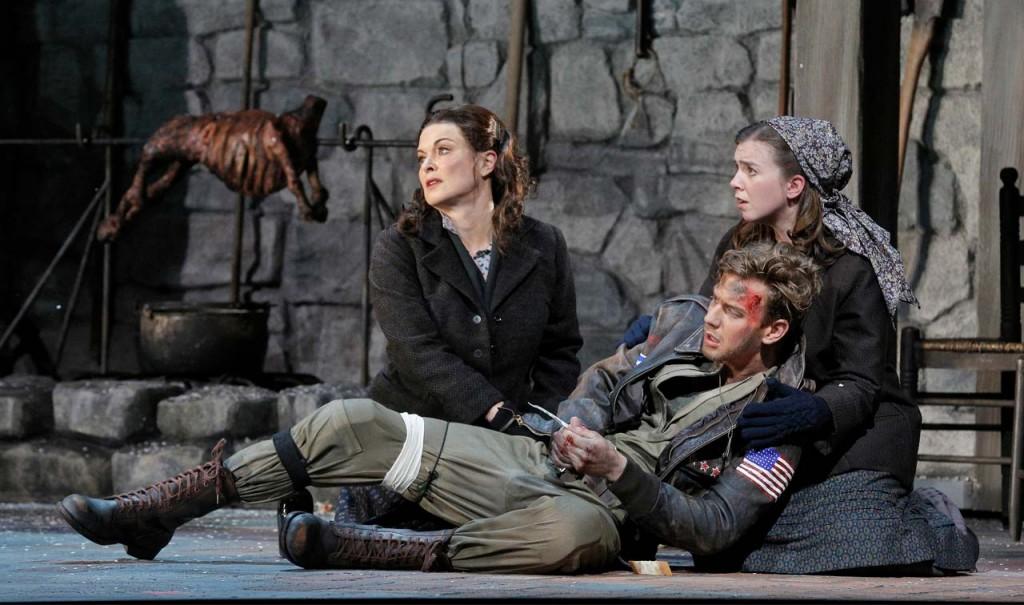 "Act I, Scene III of ""Two Women""  Anna Caterina Antonacci as Cesira, Edward Nelson as U.S. airman John Buckley and Sarah Shafer as Rosetta. ©Cory Weaver/San Francisco Opera"